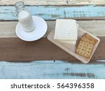 a  glass bottle of milk with... | Shutterstock . vector #564396358