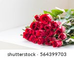 Stock photo red roses on white table for valentine s day 564399703