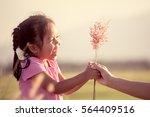 happy asian little girl giving... | Shutterstock . vector #564409516