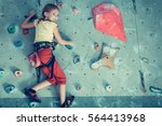 little girl climbing a rock... | Shutterstock . vector #564413968