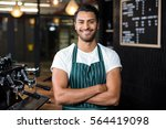 smiling barista standing with... | Shutterstock . vector #564419098