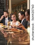 vietnamese man reading menu to... | Shutterstock . vector #564420760