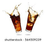 Small photo of Couple cola splashing out of a glass., Isolated white background.