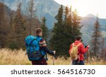 two hikers out trekking in the... | Shutterstock . vector #564516730