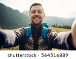 Smiling Hiker Taking A Selfie...