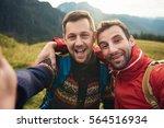 smiling hikers taking a selfie... | Shutterstock . vector #564516934