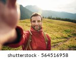 Hiker Taking A Selfie While Ou...