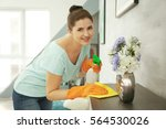 young woman cleaning furniture... | Shutterstock . vector #564530026