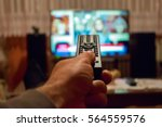 watching tv and using remote... | Shutterstock . vector #564559576