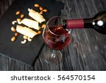 red wine with cheese on wooden...   Shutterstock . vector #564570154