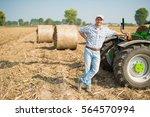 smiling farmer in his field | Shutterstock . vector #564570994