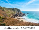 Small photo of Porth Chapel Beach at St Levan, near Porthcurno, Cornwall. The headland is known as Pedn-men-an-mere and the offshore rocks are the Carracks.