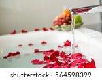 Stock photo rose petals put in bathtub for romantic bathroom in honeymoon suit arranged by interior designer 564598399
