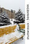 yellow benches on the winter... | Shutterstock . vector #564648544