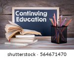 continuing education. stack of... | Shutterstock . vector #564671470