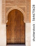 Small photo of Moorish doorway with intricate fretwork leading to the Golden Room, Alhambra Palace, Granada, Spain