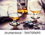 alcoholism. cup cognac or... | Shutterstock . vector #564700690