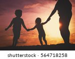 Silhouette Of Family With Kids...