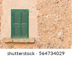 green wooden window shutters... | Shutterstock . vector #564734029