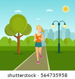 woman jogging in the park... | Shutterstock .eps vector #564735958