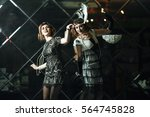 20s style concept. two pretty... | Shutterstock . vector #564745828