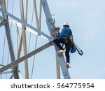 worker climbing on transmission ... | Shutterstock . vector #564775954