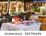 pool side candlelight dinner... | Shutterstock . vector #564796696