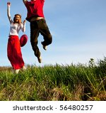 jumping couple - stock photo