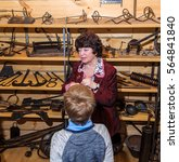 Small photo of Kolomna, Russia - January 03, 2017: Female-guide Blacksmith Settlement museum conducts a tour for kids by Andrey Kopylov, aka linkpusher