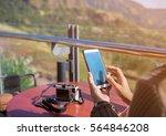 women hand hold smart phone on... | Shutterstock . vector #564846208