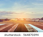 wood table and blur rice field...   Shutterstock . vector #564870394