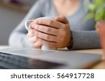 woman holds a cup in front of... | Shutterstock . vector #564917728