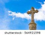 Stone Cross Against Blue Sky...