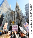 Small photo of NEW YORK CITY - JANUARY 21, 2017: People with signs, including one regarding Planned Parenthood, walk past St. Patrick's Cathedral on 5th Ave. during the Women's March in New York City.