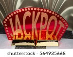 a jackpot sign with two gold... | Shutterstock . vector #564935668