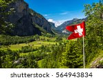the swiss flag and... | Shutterstock . vector #564943834