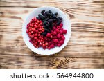 a plate with berries on a... | Shutterstock . vector #564944800