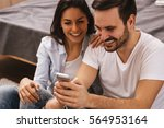 cheerful couple laughing... | Shutterstock . vector #564953164