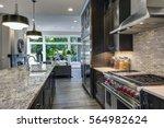 modern kitchen with brown... | Shutterstock . vector #564982624