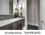 white and brown bathroom boasts ... | Shutterstock . vector #564982690