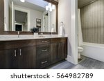white and brown bathroom boasts ... | Shutterstock . vector #564982789