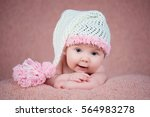 newborn baby in a warm knitted... | Shutterstock . vector #564983278