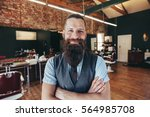 portrait of happy young barber... | Shutterstock . vector #564985708