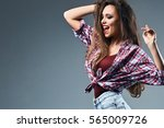 sexy young girl with disheveled ... | Shutterstock . vector #565009726