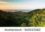 caribbean sunrise from roatan... | Shutterstock . vector #565015360