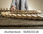 Hand Stopping Domino Effect Of...