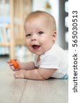 cheerful baby in the prone... | Shutterstock . vector #565030513