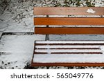 snow covering a wooden park... | Shutterstock . vector #565049776