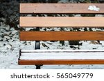 snow covering a wooden park... | Shutterstock . vector #565049779