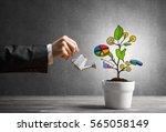 hand of businesswoman watering... | Shutterstock . vector #565058149